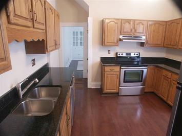 Ken wightman inc harrison west 1263 harrison ave for Hardwood floors with oak cabinets